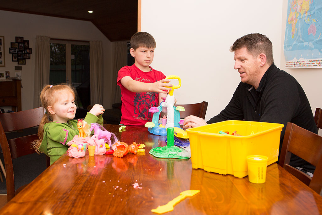Thumbnail Image of Alyssa and Ashton playing with their father Mark