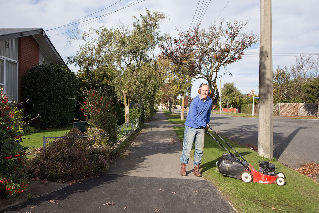 Thumbnail Image of Man mowing the lawn