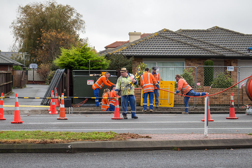 Thumbnail Image of Road workers installing internet fibre cable, Harewood Road