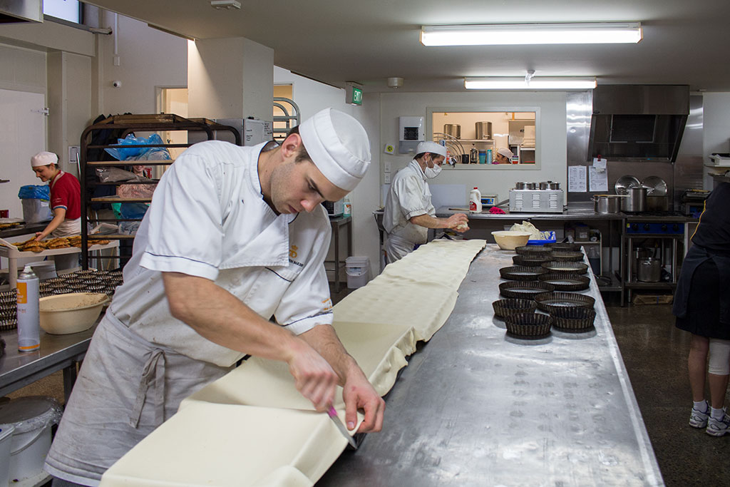 Thumbnail Image of Apprentice chef preparing pastry at Copenhagen Bakery