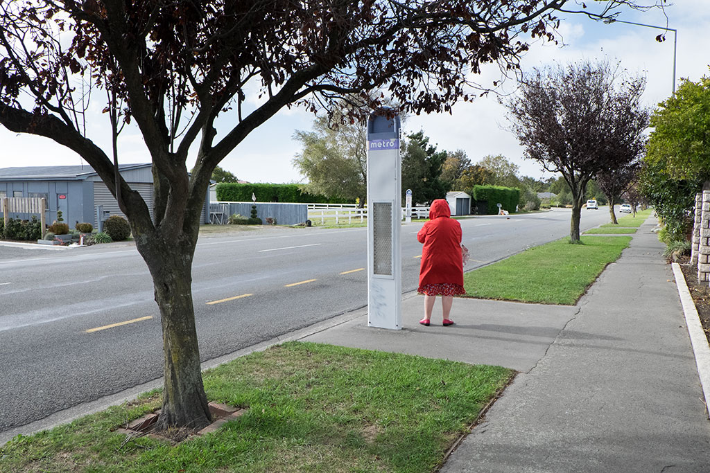 Woman waits at bus stop on Dunbars Road by Ellenor Waters CCL-HP2015-EW-DSCF1918