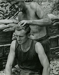 "photo from Norman Piersons Korean War collection: ""Getting my short back and sides"""