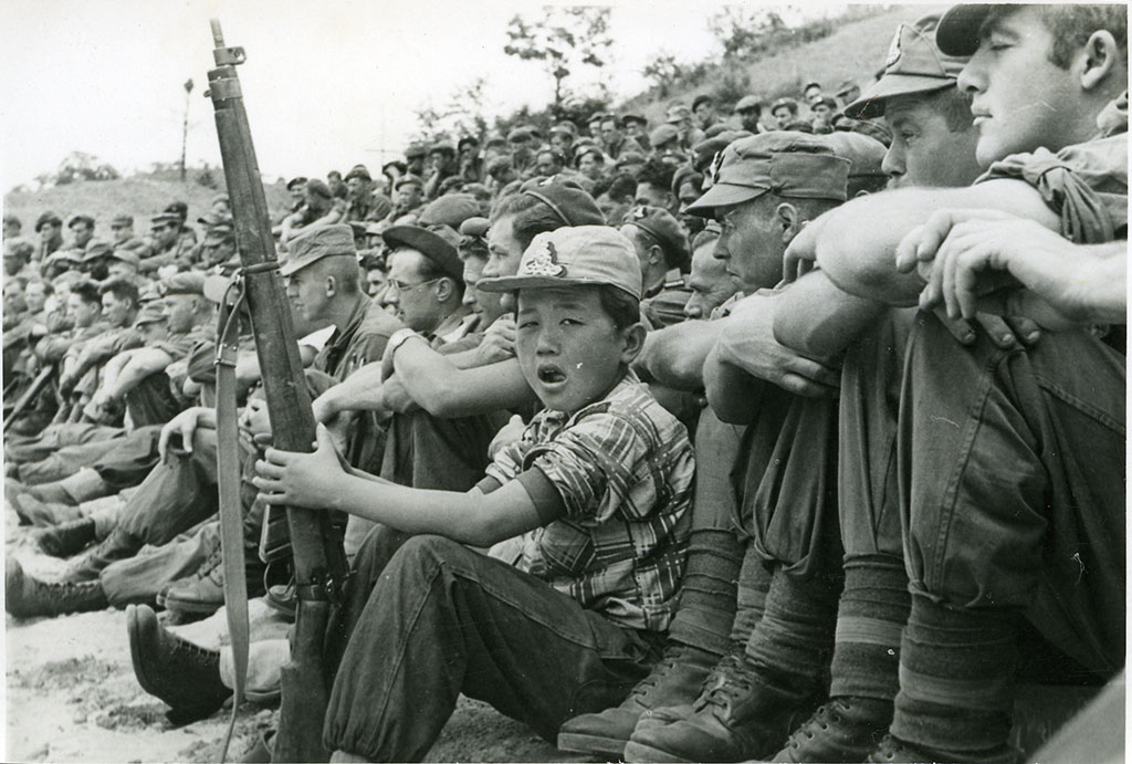 Kim at the concert with 303 rifle. Norman Oswald Pierson. 1951-1952. CCL-Pierson-CCL-PH-0034